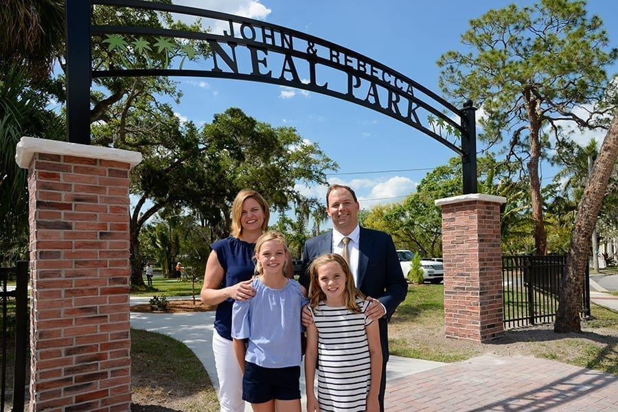John Neal and family at entrance to John and Rebecca Neal Park