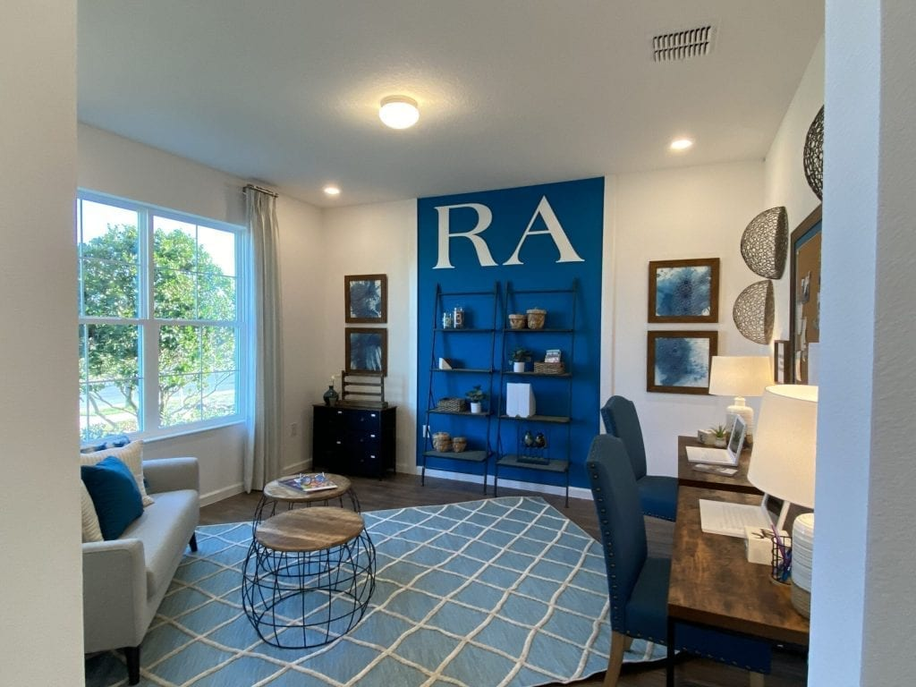 Blue wall in den new home model north river ranch